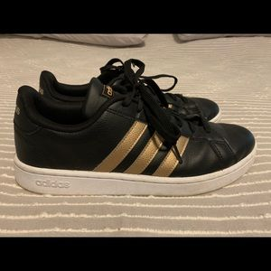 Adidas black and gold sneakers